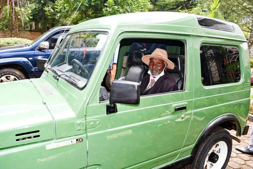 Mzee Kurgat was all smiles as he received the car from Oscar Sudi. Photo: Oscar Kipchumba Sudi.