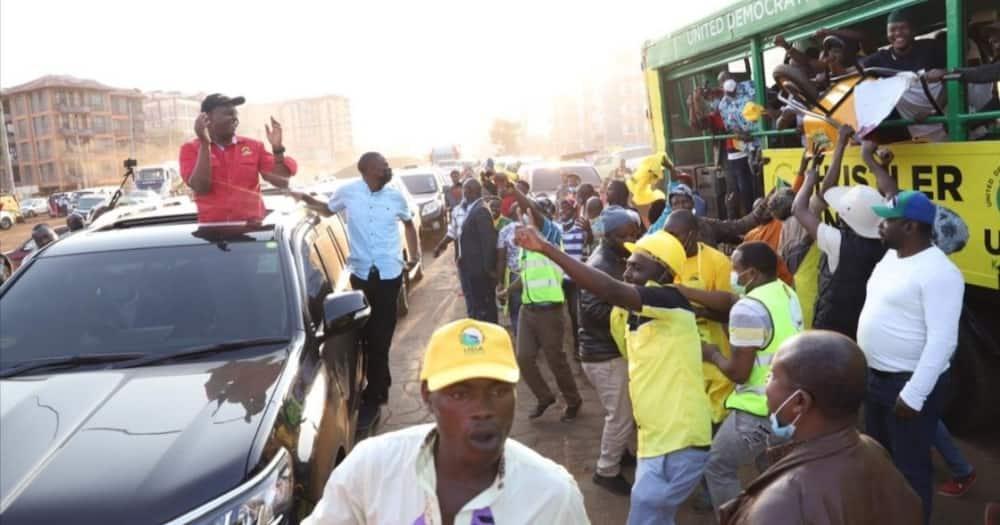Amos Kimunya interacts with UDA supporters in Kiambaa.