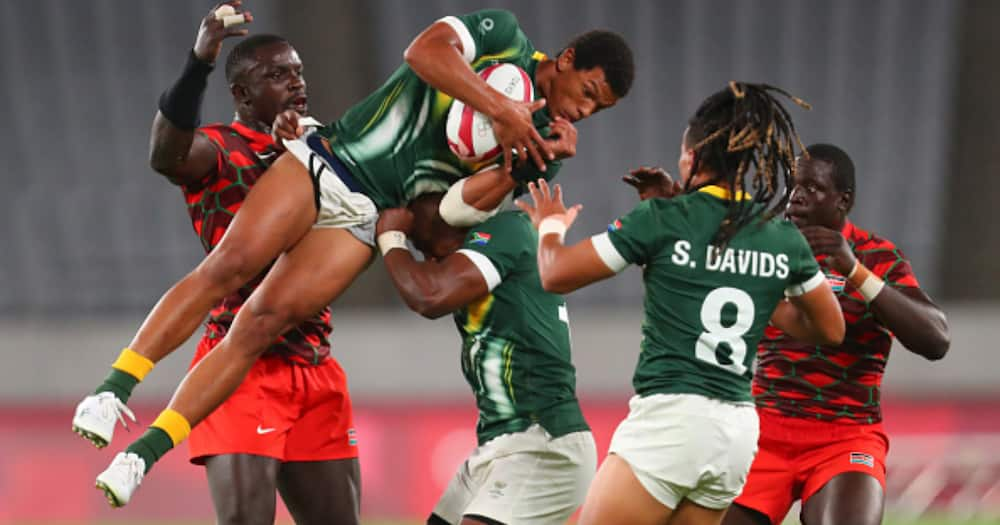Kurt-Lee Arendse of South Africa is lifted high into the air by Siviwe Soyizwapi during the Rugby Sevens match between South Africa and Kenya in Tokyo, Japan. (Photo by Roger Sedres/Gallo Images/Getty Images)
