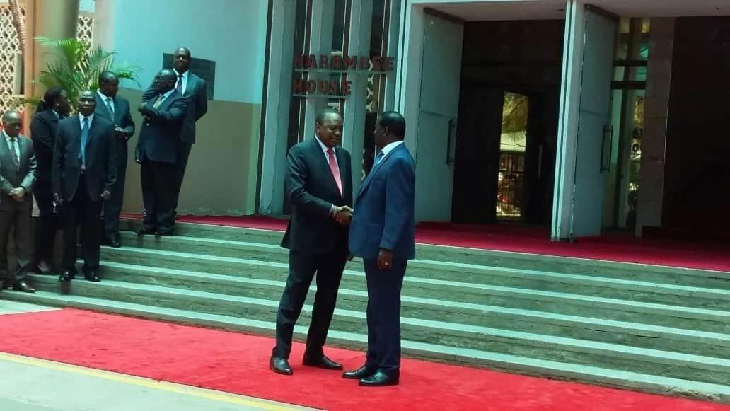 President Uhuru Kenyatta shakes hands with NASA coalition co-princiapl Raila Odinga at Harambee House, Nairobi.