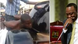 Weird: Man removes shirt and cleans NASA governor's car during a rally