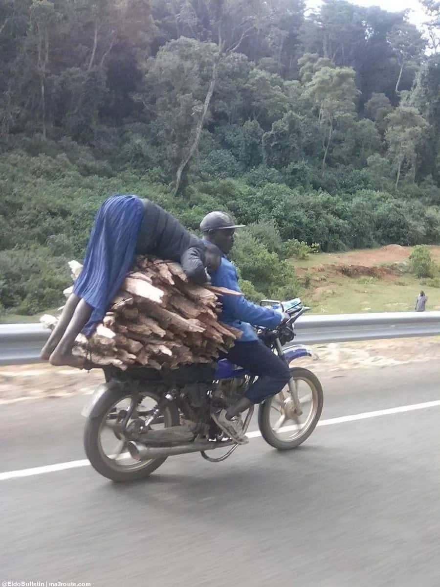 Outrage as woman is spotted clutching dangerously on motorbike ferrying firewood in Elgeyo Marakwet