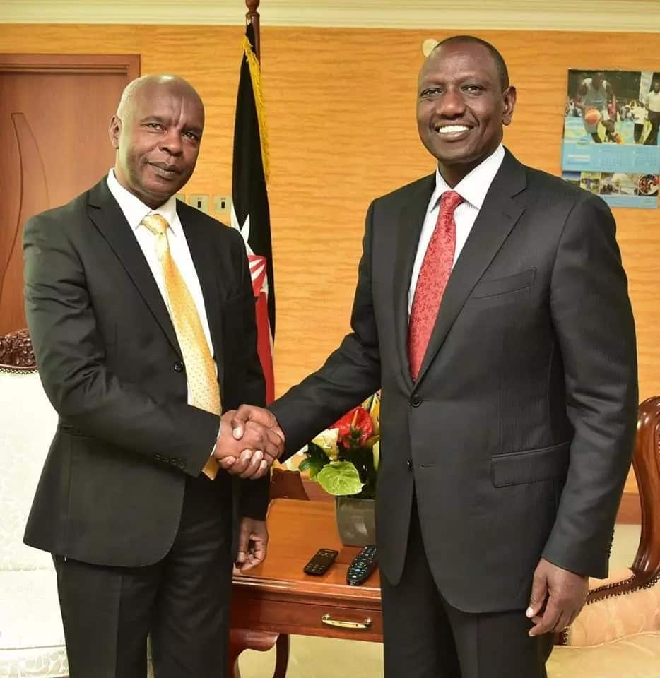 Makueni County governor Kivutha Kibwana shaking hands with Deputy President William Ruto at his offices in Harambee Annex, Nairobi.