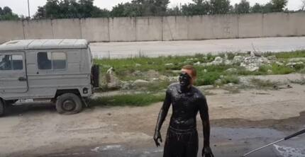 Crazy guy jumps into a pool of oil but then this shocking thing happens (photos, video)