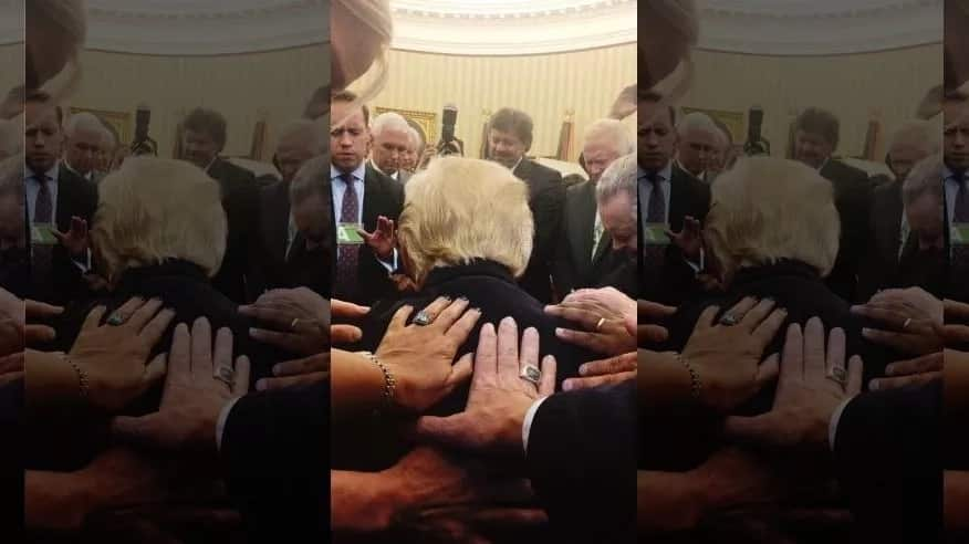 Delight and wonder as Trump is seen bowing in prayer during Oval Office session