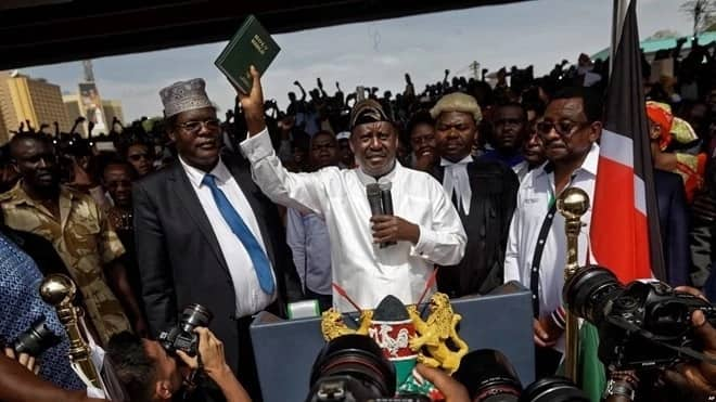 Orange Democratic Movement (ODM) party leader Raila Odinga holding a Bible during his controversial swearing-in ceremony on January 30, 2018, at Uhuru Park.