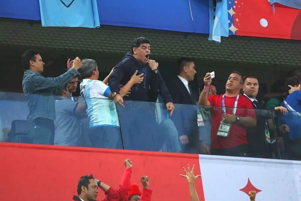 Argentina's legend Maradona in middle-finger celebration after his side's narrow escape
