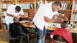 Hopes from this barber... Free haircuts to keep boys from becoming GANGSTERS (photos)