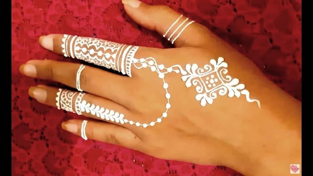 Stylish white henna designs for hands