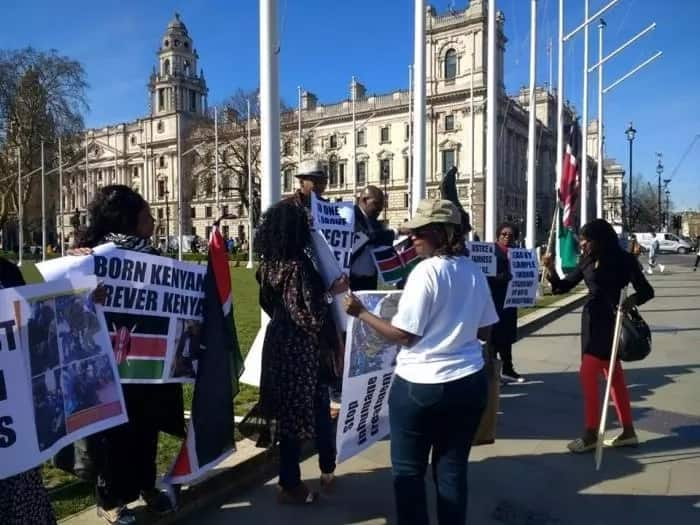 Some of the National Resistance Movement (NRM) Kenya supporters in the UK held placards defending Miguna's Kenyan citizenship. Photo: Miguna Miguna/Facebook.