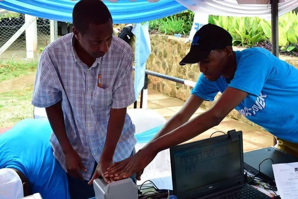 A man being helped by a NHIF staff to register for the health insurance scheme. Quality health provision is one among the Big Four agenda premised by President Uhuru Kenyatta. Photo: NHIF