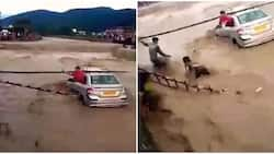 Heroic! Watch dramatic moment man plunges into raging floodwaters to save struggling woman