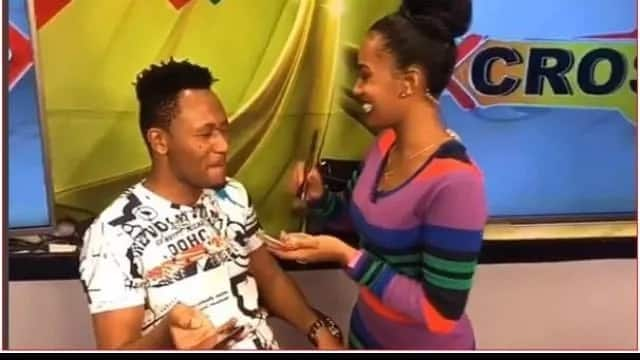 Behind the scenes photos of DJ Mo and co-host Grace Ekirapa continue to raise eyebrows