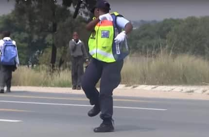Viral video of DANCING traffic guard will put a smile on your face (photos, video)