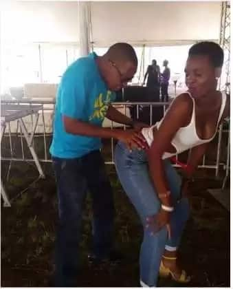 DNG dances sensually with a girl at the Sauti Sol concert