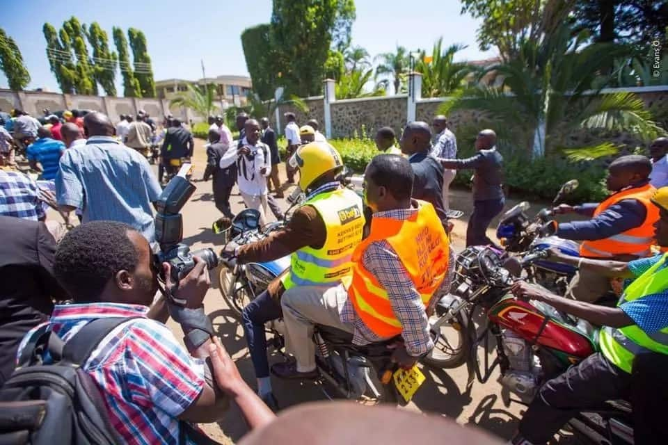 Raila endangers his life by riding a boda boda without a helmet