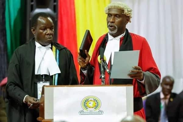 Charles Nyachae taking oath as a judge at the East African Court of Justice.