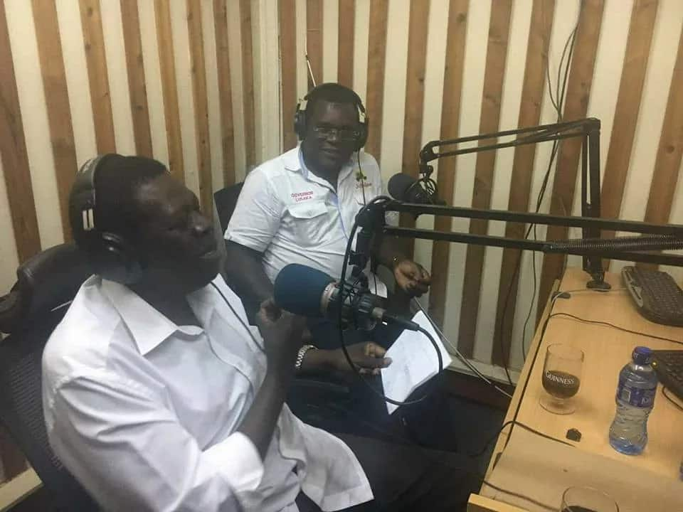 Viral photos of Jubilee's western Kenya point-men attending a radio interview with a glass of alcoho