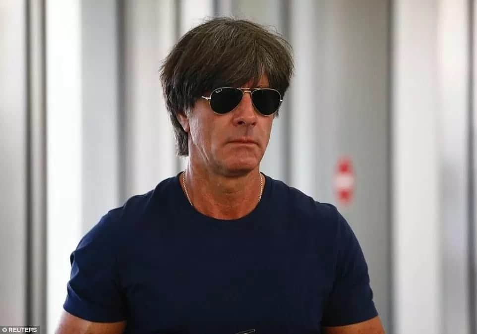 Joachim Low hides behind sunglasses as humbled Germans fly back after crashing out of the World Cup