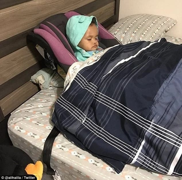 Aaron tucked his daughter to bed while she was still strapped to her car seat. Photo: Twitter/alhaila