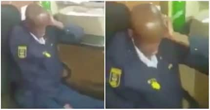 Police officer caught napping as members of public wait for assistance