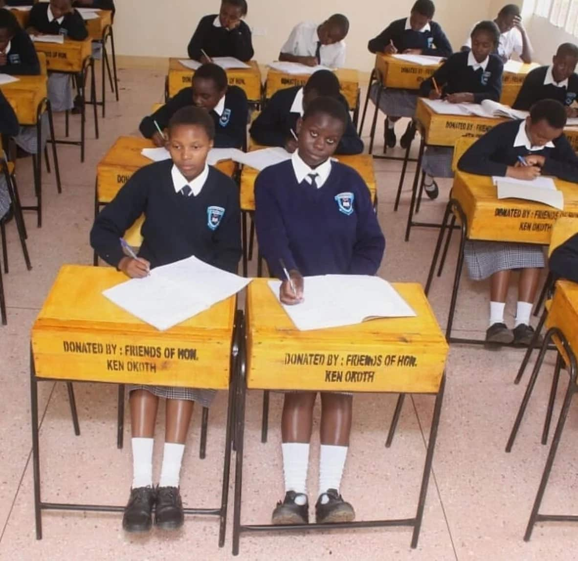 Students sitting on new desks donated by Kibera MP Ken Okoth