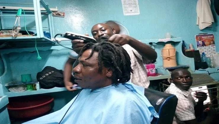 Man who vowed to shave his 10-year-old deadlock if Raila takes oath keeps his promise