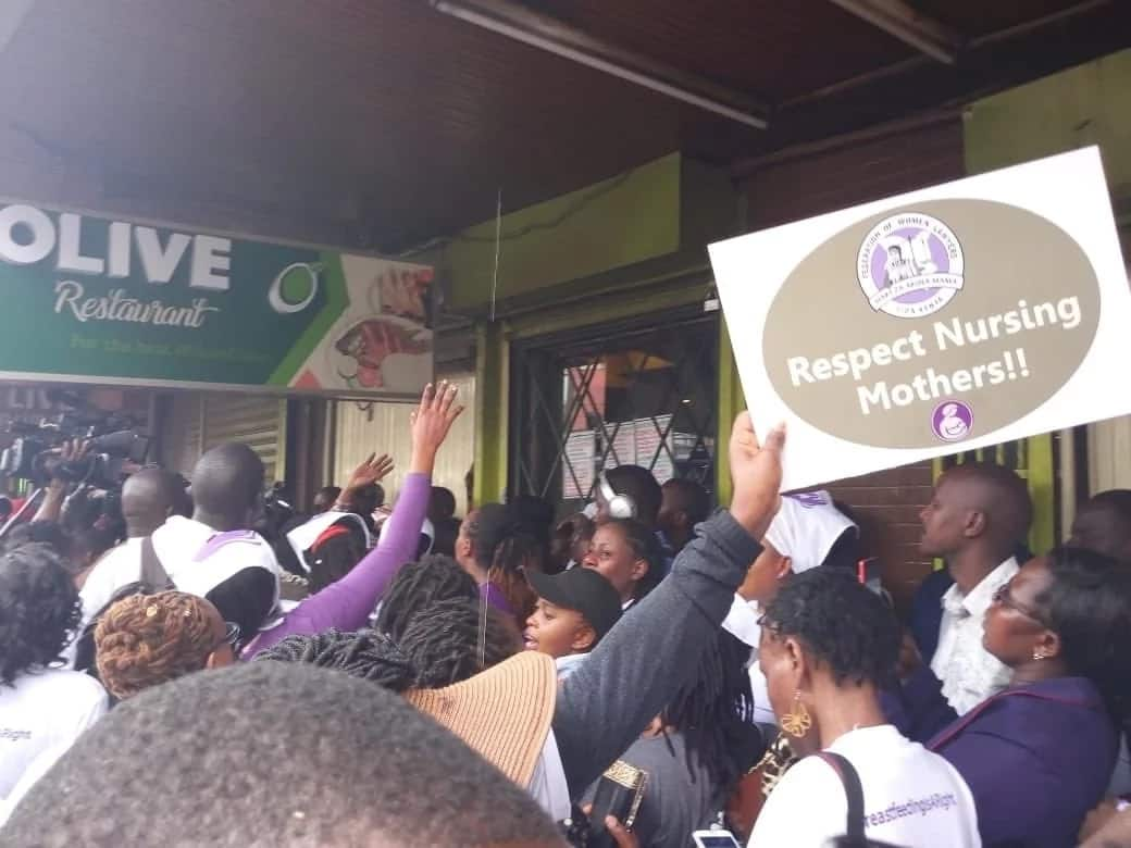 Angry Women hold protests outside Olive restaurant after it kicked out breast feeding woman