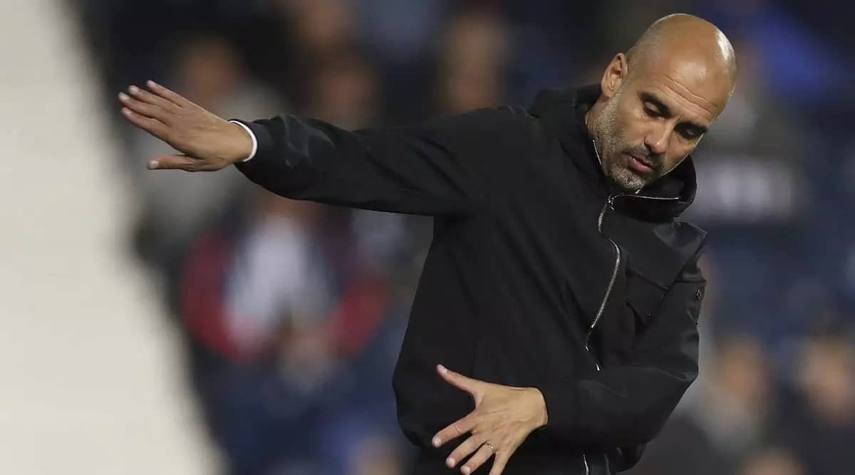 Guardiola reacts to his wards' Champions League defeat at Liverpool