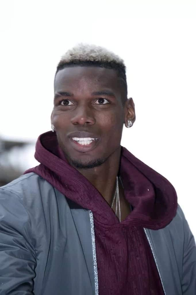 Pogba show cases flamboyant lifestyle with customized suit and shoe
