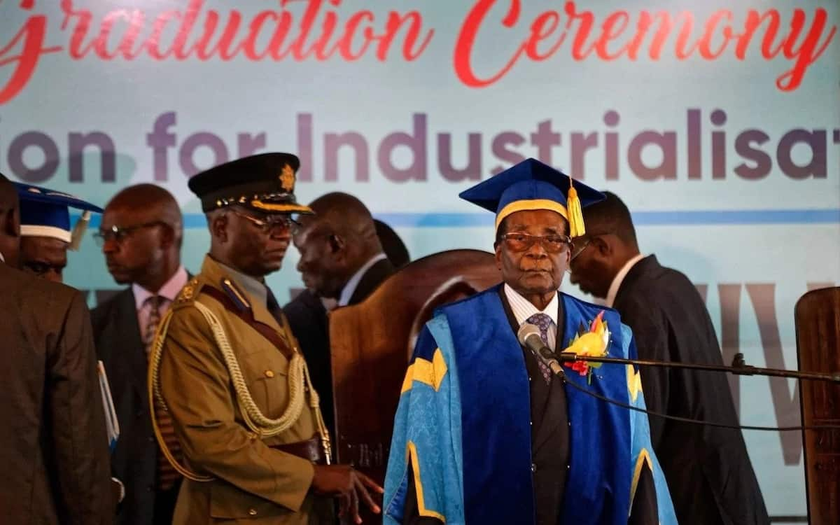 Robert Mugabe attends graduation ceremony after military coup