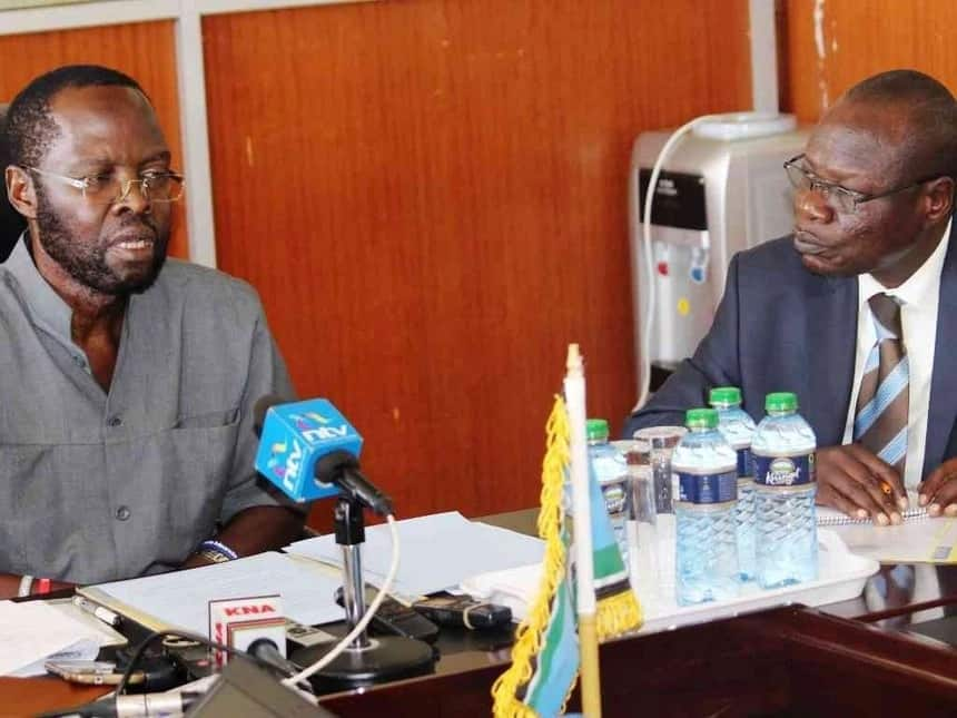 Kisumu Governor Anyang' Nyong'o and sacked Chief of Staff Patrick Lumumba Ouya in a previous meeting. Ouya was sacked after he threatened to shoot the governor. Photo: Kisumu Governor Press Unit.