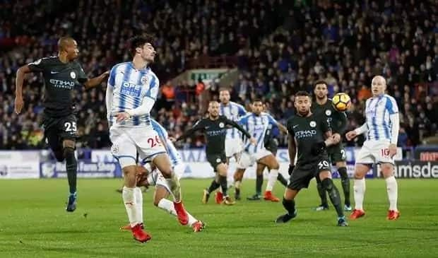 EPL pacesetters Manchester City sink Huddersfield 2-1 to go eight points clear