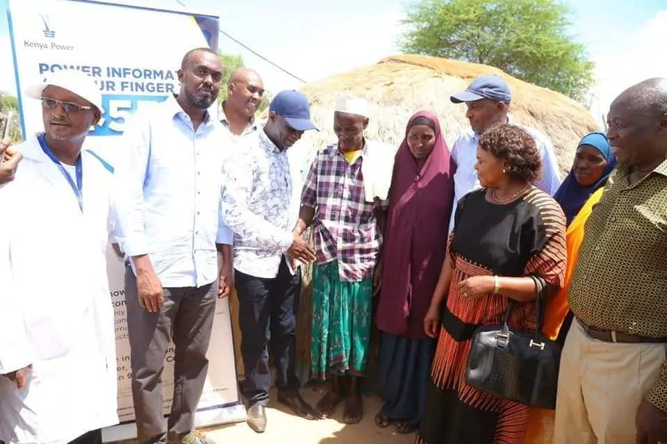 Aden Duale, energy cabinet secretary oversee electricity connection to grass-thatched houses