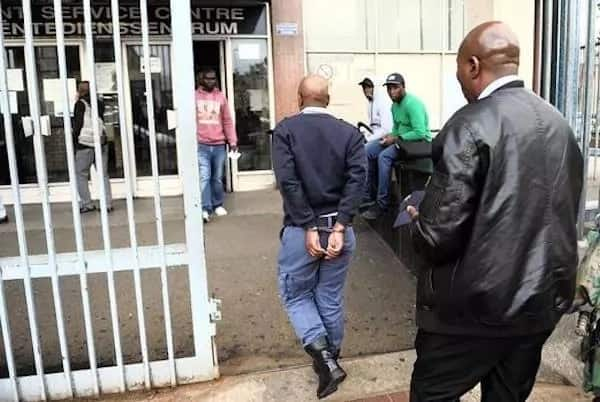 The policeman pictured soon after his arrest. Photo: The Star