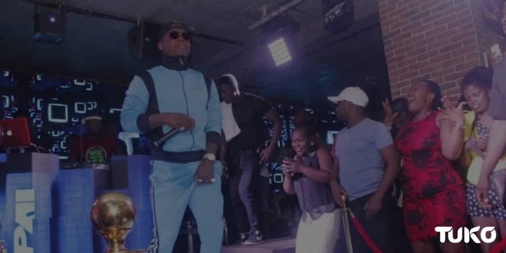 Photos showing Tanzanian singer Harmonize wet himself while grinding Kenyan lady on stage