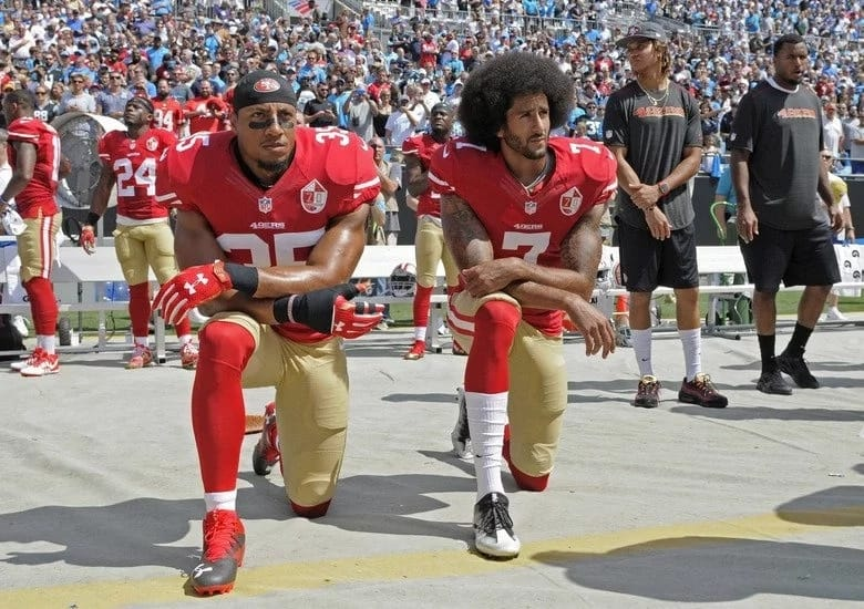 Sportsmen and women have been taking a knee in protest. Photo: The Seattle Times