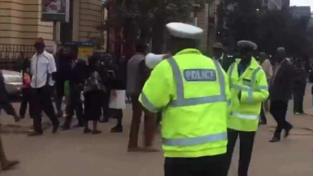 Nairobi police officers announcing controversial Prophet Owuor's next crusade leave tongues wagging