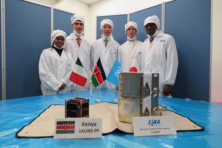"A team from the University of Nairobi handing over to JAXA the Satellite it had developed known as ""First Kenya University Nano Satellite-Precursor Flight."