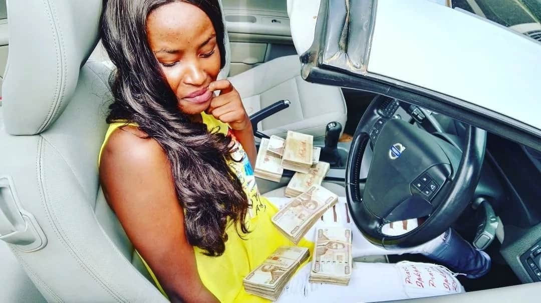 Kenyan girl leaves tongues wagging after flaunting millions of shilling stuffed in sacks