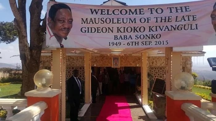 Mike Sonko shows off late dad's expensively decorated resting place fitted with gold crosses, red carpet