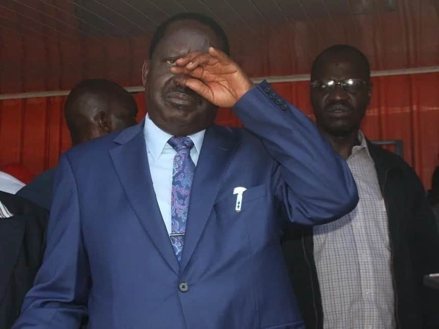 13 photos of Raila struggling to wipe tears from his left eye and the story behind it