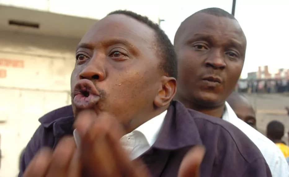 Image result for uhuru kenyatta laughing