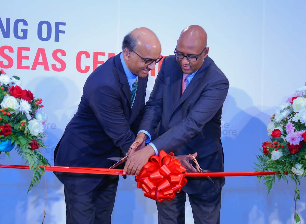 Singapore Deputy Prime Minister Tharman Shanmugaratnam (L) together with CS Adan Mohamed cut the ribbon during the official opening of the Enterprise Singapore Nairobi Overseas Center.Photo:TUKO.