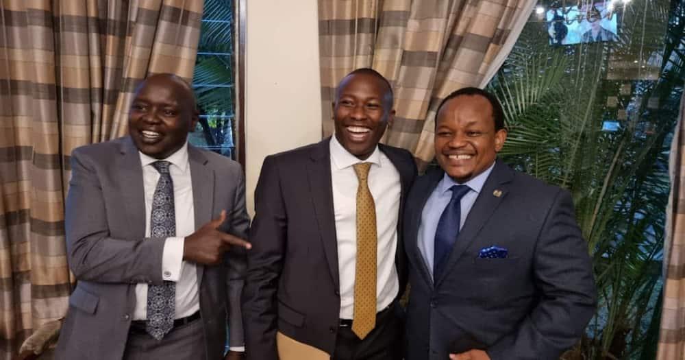 Ngunjiri Wambugu (right) shares a light moment with Senator Cherargei (left)and Kiambaa MP John Wanjiku.