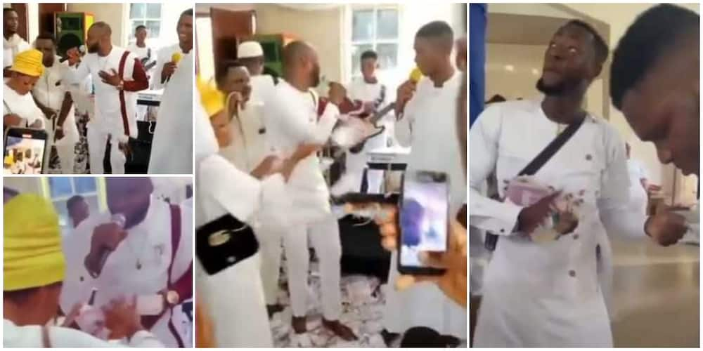 The family members sprayed cash on a male chorister in church.