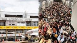 Ugandan Men Praying for Safe Landing of Female Afghanistan Refugees Catch Minister's Attention