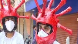 Volunteers Wear Virus-Shaped Helmets to Promote Adherence to COVID-19 Protocols