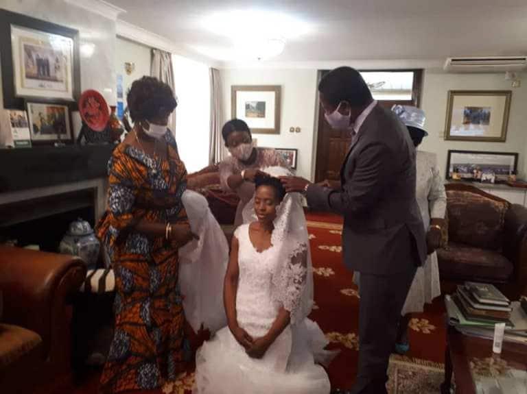 Zambia's president Edgar Lungu emotional as he walks daughter Tasila down the aisle