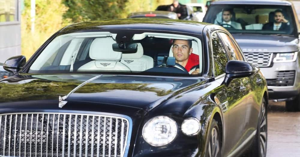 Ronaldo drove a top-spec Bentley Flying Spur as he arrived for Man United training. Photo: The Sun.